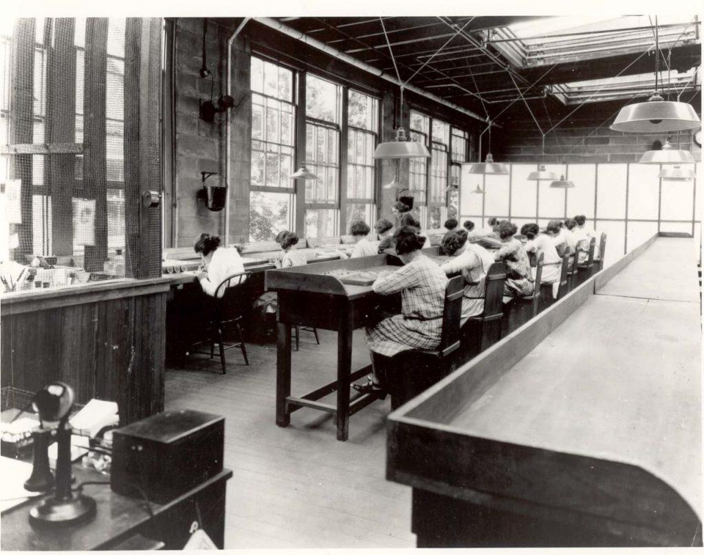 In 1922, Radium Girls worked in a factory for the United States Radium Corporation, which made a luminescent paint called Undark, used on fashionable watch dials. (From the Rutgers University Libraries, via WikiCommons)