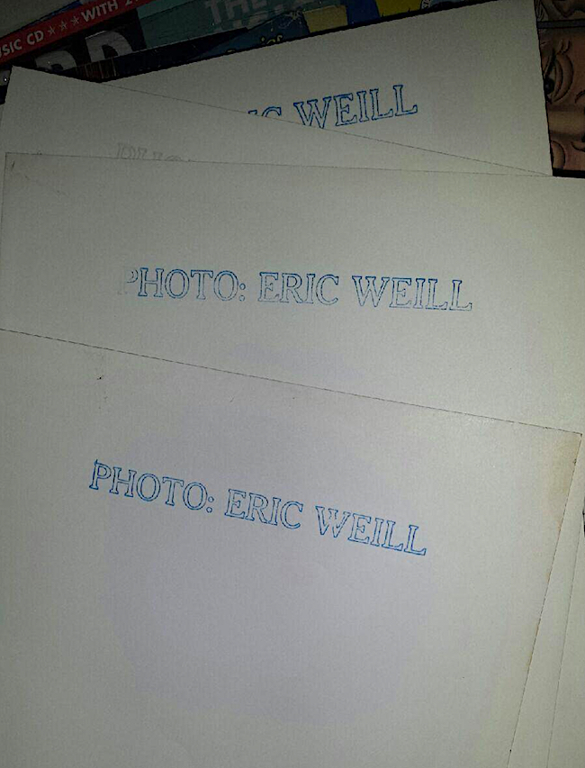 Almost all of Eric Weill's photographs have this stamp on their backs, but the contact sheet did not.