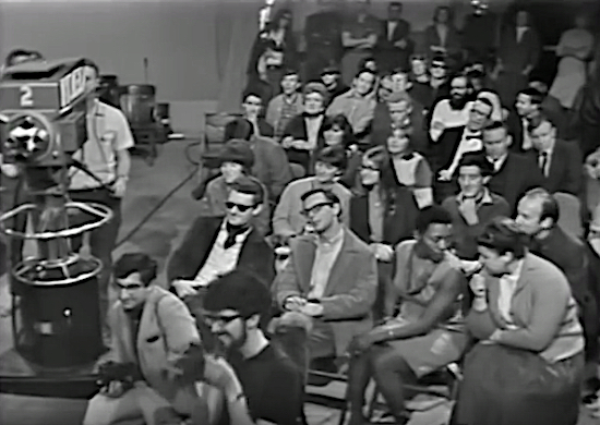 Eric Weill (bottom, center-left) photographing Bob Dylan at the singer-songwriter's 1965 press conference in San Francisco.