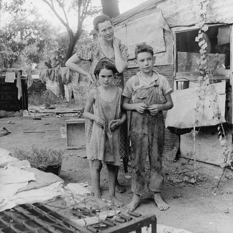 A poor mother and children living in a shantytown in Elm Grove, Oklahoma, during the Great Depression and Dust Bowl, circa 1936. (Photo by Dorothea Lange, via Library of Congress)