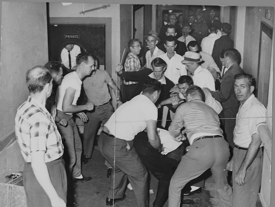 A mob beats Freedom Riders in Birmingham, Alabama in May 1961. This picture was reclaimed by the FBI from a local journalist who also was beaten. (Via WikiCommons)