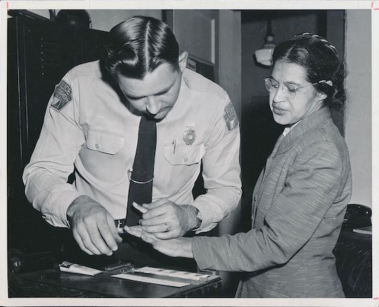 Civil rights activist Rosa Parks, then 43 years old, was fingerprinted by Deputy Sheriff D.H. Lackey after being arrested for boycotting public transportation, Montgomery, Alabama, in February 1956. (Via WikiCommons)