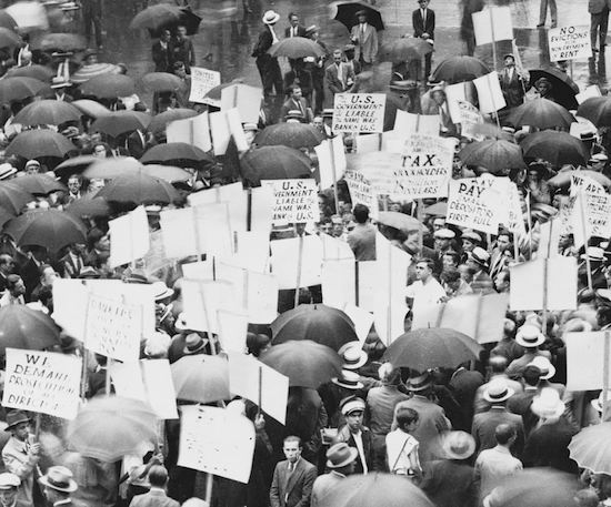 In 1931, a crowd gathered in the rain outside the Bank of United States after its failure. (Via New York World-Telegram & Sun Collection, Library of Congress)