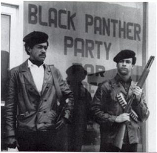 Black Panther Party founders Bobby Seale (left) and Huey Newton, armed with shotguns. (Via WikiCommons)