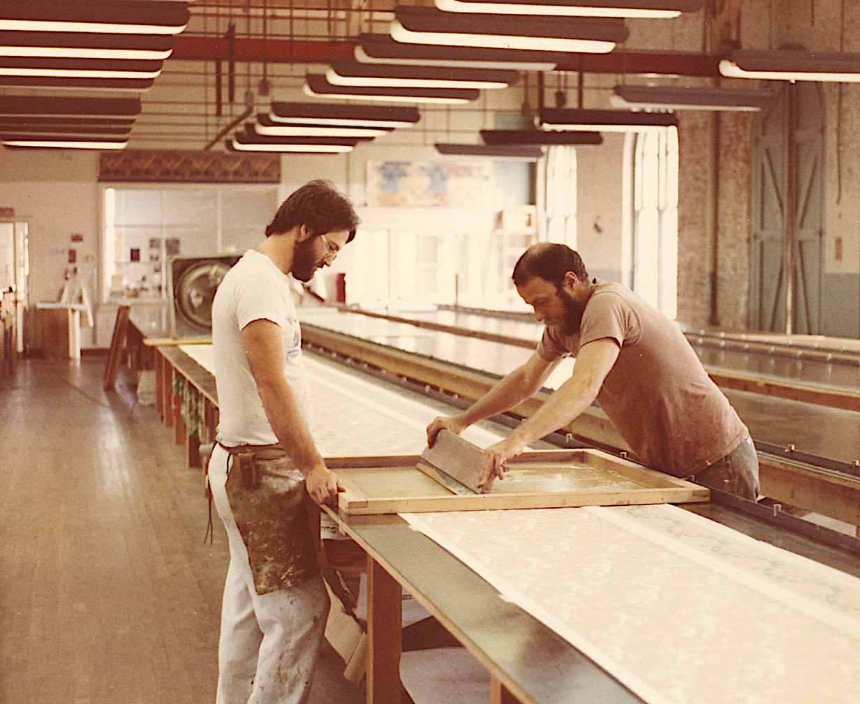 Bruce Bradbury (right) printing with an early Bradbury & Bradbury employee named Jeff Williams.
