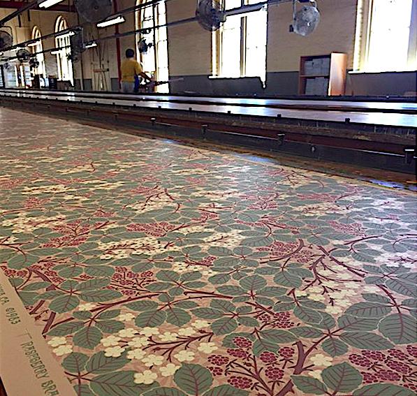 """Raspberry Bramble,"" drying on the 90-foot-long tables at Bradbury & Bradbury. In the background is printer Jules Valdez."