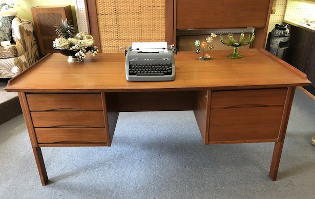 One of Cerny's first loves is Mid-Century Modern furniture. This desk is from the Broadway Antique Market.