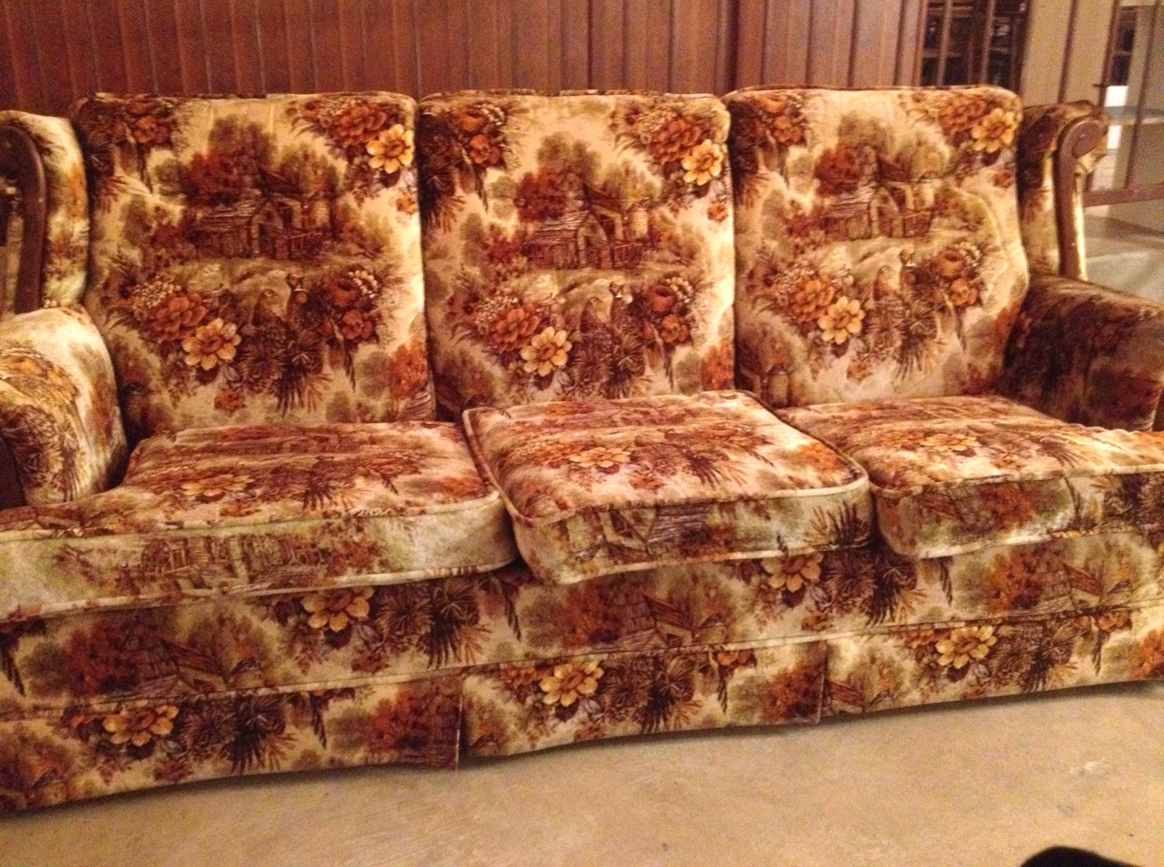 2f3331feb3 Over a picture-patterned sofa in an autumnal-colored velour with scrolling  dark wood trim