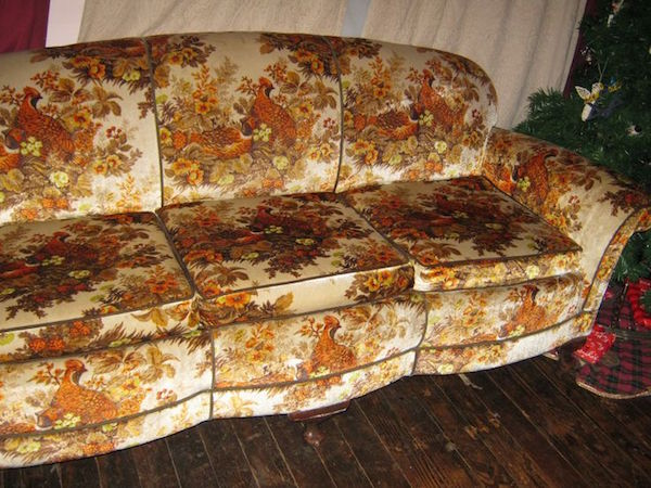 Game birds roost among wildflowers on this fake-velour '70s Grandma Couch next to a Christmas tree. (Pinterest)