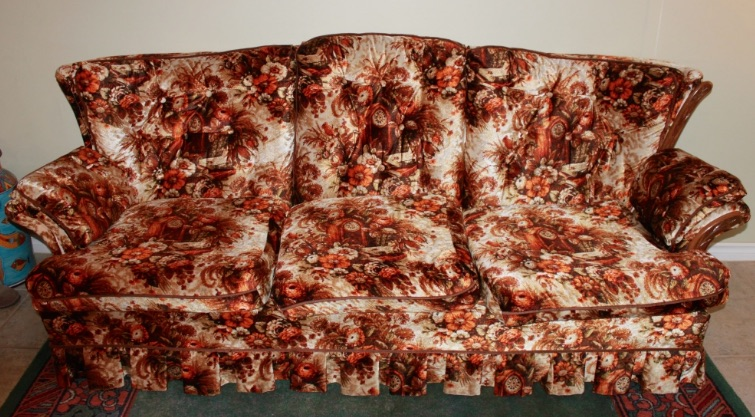 Depending on the meme, everyone—or everyone's grandma—had this particular sofa. Here, the busy pattern on the synthetic velour includes a rustic cuckoo clock. At least, I think that's what's happening.