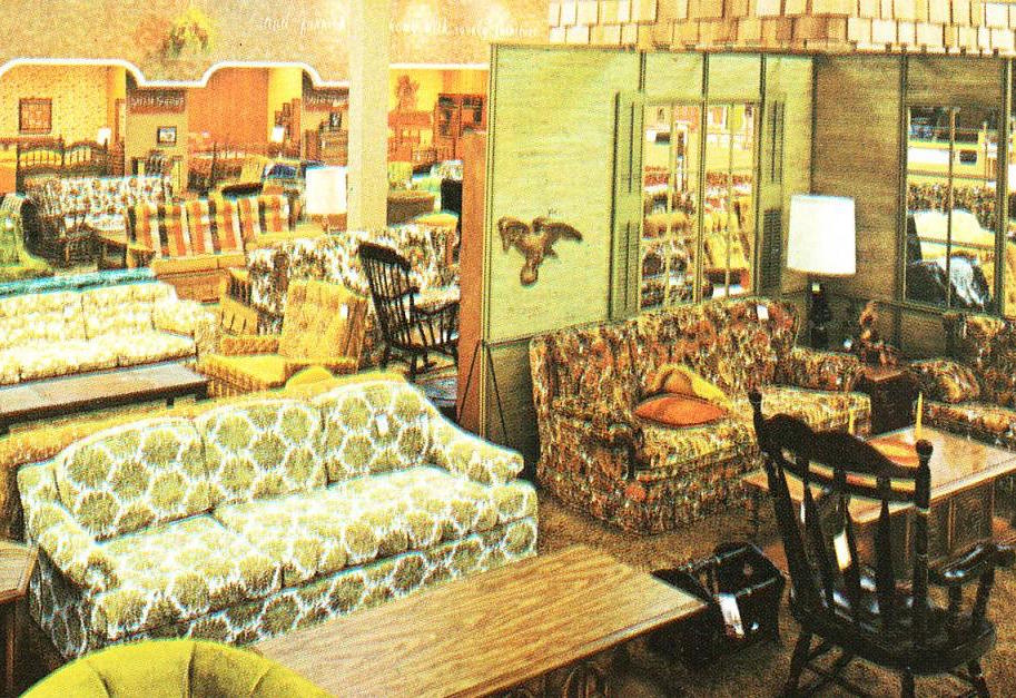 On the right side of this 1970 image of a Montgomery Ward floor, you can see a brown floral couch similar to my grandma's, as well as a Colonial Revival coffee table that resembles hers, but with different hardware. In the background is an orange plaid couch. (Via Pleasant Family Shopping)