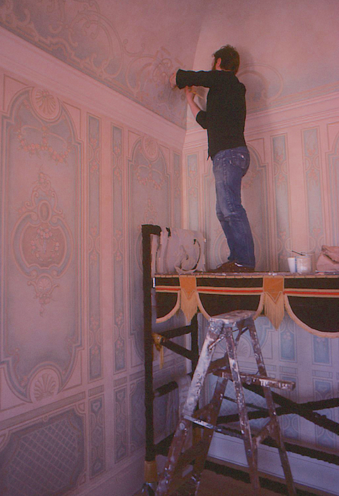 Tom Ciesla painting the ballroom of Jessica McClintock San Francisco residence. Photo by Ken Huse.