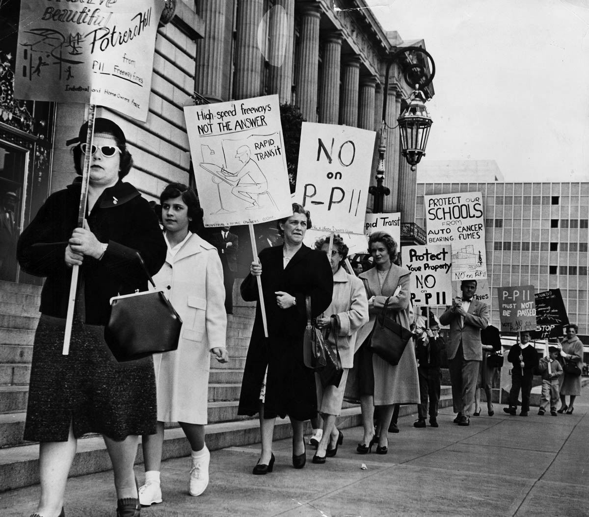 Residents protesting the Southern Freeway project at San Francisco's City Hall in the late 1950s. Via the San Francisco History Center, San Francisco Public Library.
