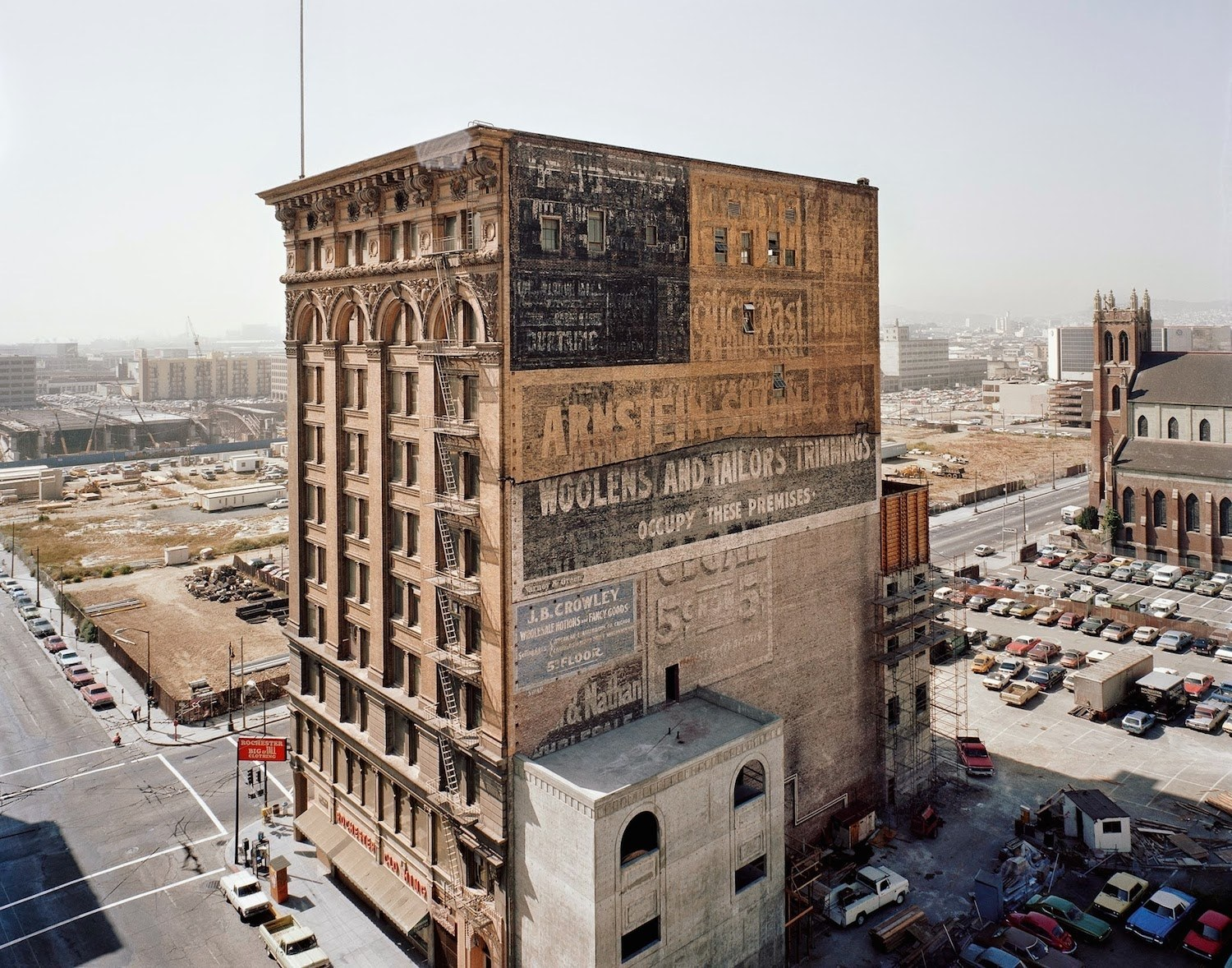 "The Mercantile Building stands amid the redevelopment of the South of Market neighborhood's ""skid row"" in 1980. Photograph by Janet Delaney."