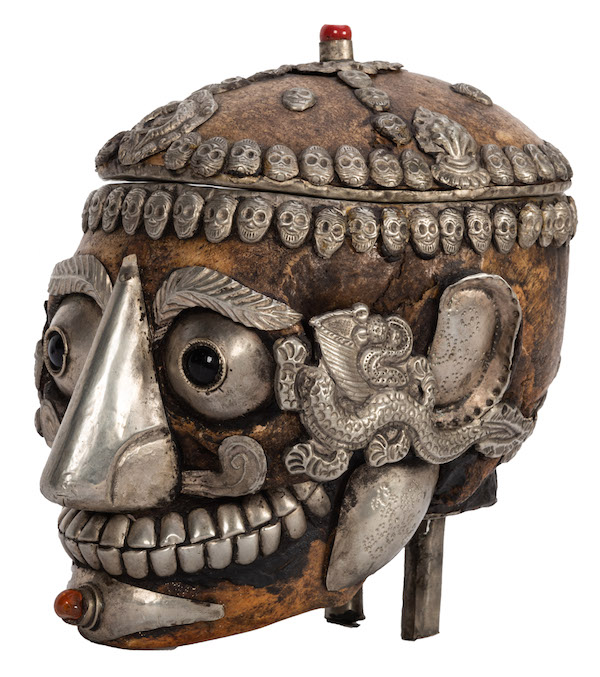 A mid-20th-century Tantric Himalayan Buddhist ritual Kapala skull, or a human skull decorated with semi-precious stones, glass eyes, and Tibetan silver work. (Courtesy of Potter & Potter Auctions)