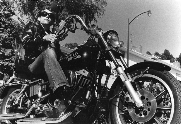 In addition to a love of music, Kaukonen has always had a passion for motorcycles. This shot of him on a favorite Harley in San Francisco was taken by Margareta Kaukonen, via St. Martins.