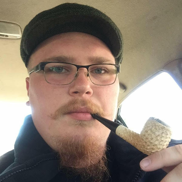 "Tyler Thomas, a 23-year-old sound engineer in St. Paul, Minnesota, began pipe smoking after seeing hobbits smoke in the ""Lord of the Rings"" movies. He's pictured with his favorite pipe. He says smoking calms his road rage."