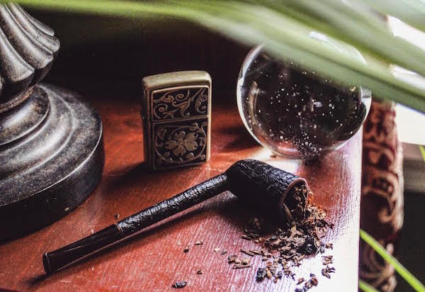 This artful photograph of a pipe, a lighter, and loose tobacco reveals the hobby's aesthetic appeal. (Photography by Mary Walters of Walters Photography)