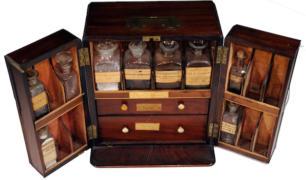Mahogany box with medicines in glass bottles, scales, and weights, c. 1850. This chest belonged to Dr. C. Winslow, a doctor and pharmacist in North Carolina. M. Donald Blaufox Collection.