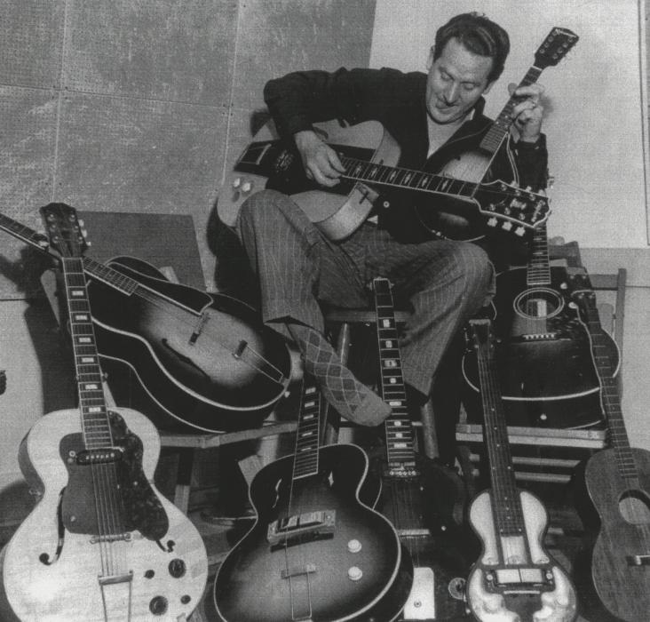 Les Paul with a few of his clunker guitars.