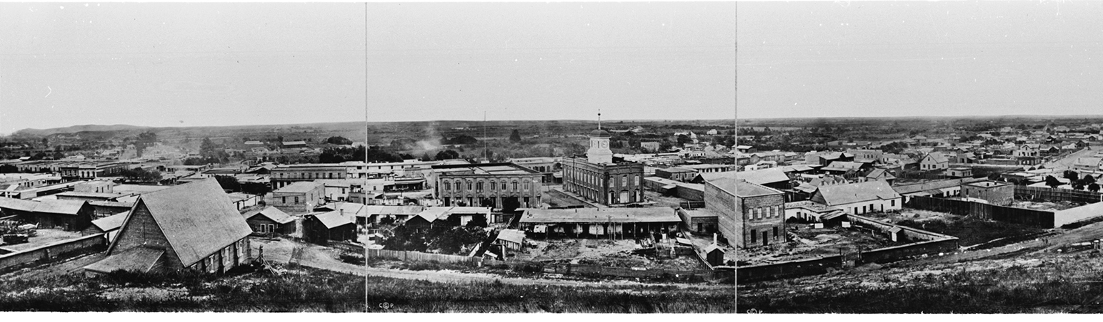 Part of Stephen Rendell's panorama of Los Angeles looking east from the hillside above Broadway, 1869, later rephotographed by C.C. Pierce. Rendell may have removed himself from the right of the building in the foreground. Courtesy the California Historical Society, USC Libraries Special Collections, Title Insurance and Trust, and C.C. Pierce Photography Collection, 1860- 1960. (Click to enlarge)