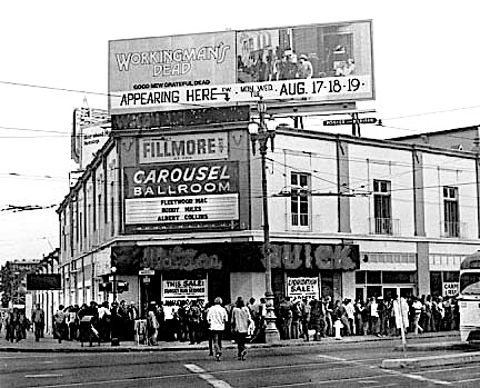 A crowd waiting to get into the Fillmore West was a common sight at the corner of Market and Van Ness. Singer designed the poster for the 1970 show on the marquee, which advertised Fleetwood Mac, Buddy Mills, and Albert Collins.