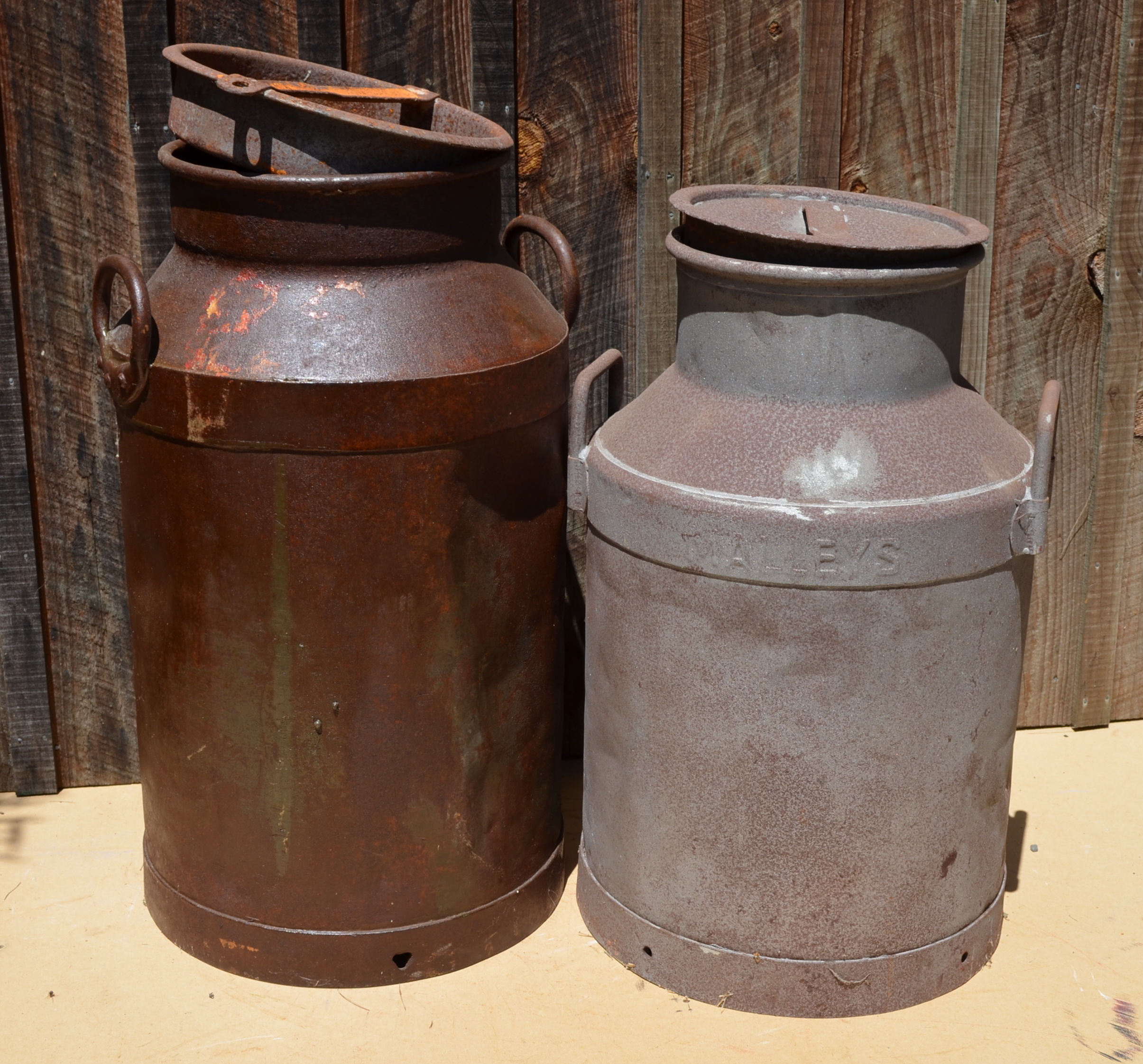 The milk can on the right is the first one in Spellerberg's collection. The one on the left was purchased at farm auction in New Zealand.