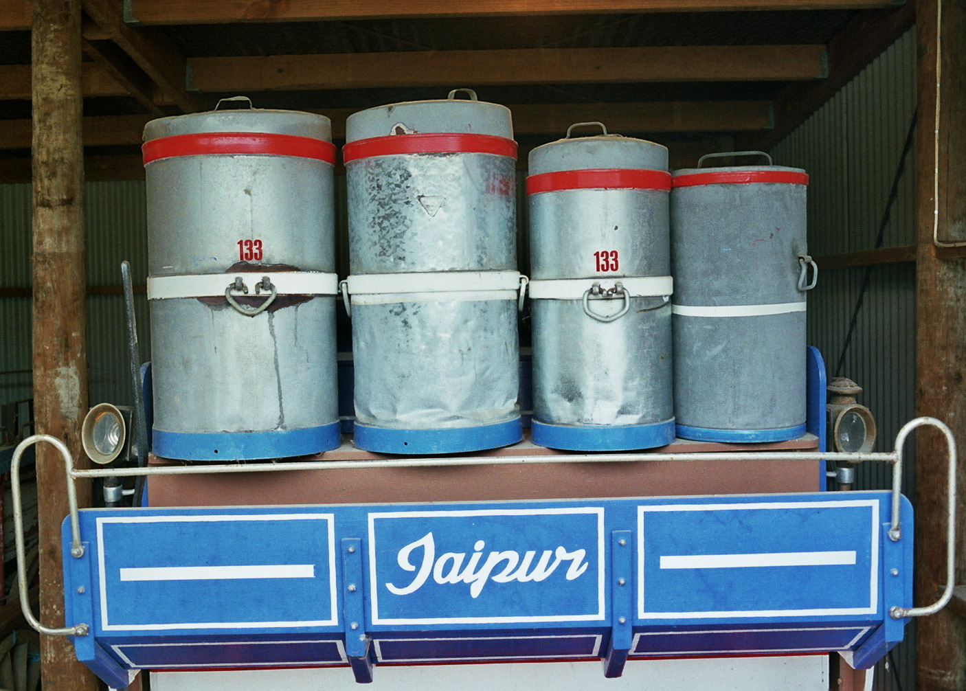 These galvanized cans are from the 1950s and were made by Hardley's of Auckland, New Zealand. Spellerberg acquired them only recently from the family of a North Island dairy farmer.