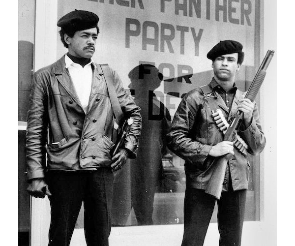 The Black Panther Party armored themselves in buttoned black leather in order to present a resistant, unified front in the late '60s and early '70s. This photo shows Black Panther leaders Bobby Seale and Huey P. Newton armed, wearing their trademark black leather jackets.