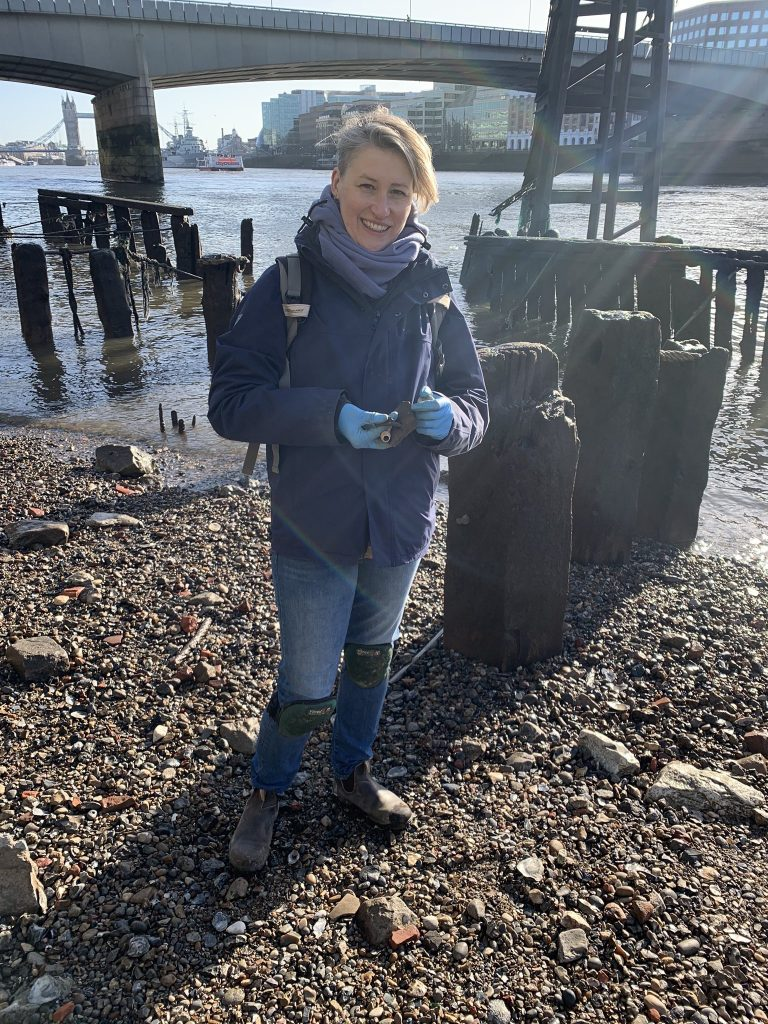 Lara Maiklem holds items found on the foreshore of the Thames in central London. Courtesy Lara Maiklem.
