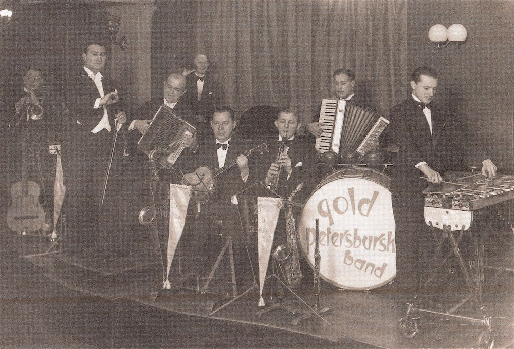 The Artur Gold (conducting) and Jerzy Petersburski (on accordion) band, circa 1930s. Via Wikimedia Commons.