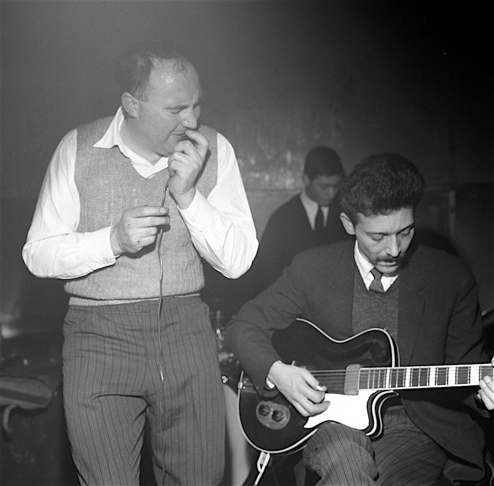 Guitarist Alexis Korner and singer Cyril Davies are credited with starting the R&B revival movement in the U.K. For this 1962 session at the Ealing Club in London, future Rolling Stones drummer Charlie Watts is sitting in. (Photo by David Redfern/Redferns)