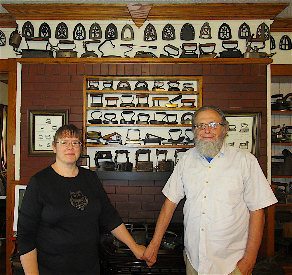 Kate and Kevin McCartney with small portion of Kevin's iron collection on display at the Old Iron Inn.