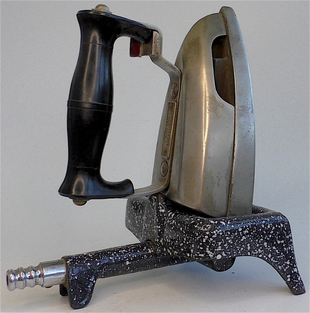 This circa 1920 British gas-jet iron rests on a graniteware base. When connected, flames shot into the iron, heating its base.
