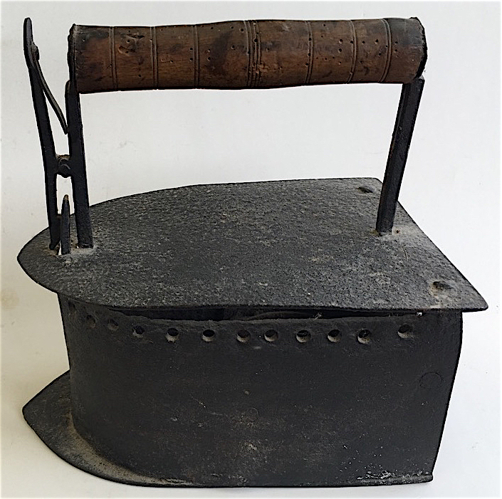When the top of this late-1700s French iron was raised, it could be filled with hot coal to heat the iron's base.