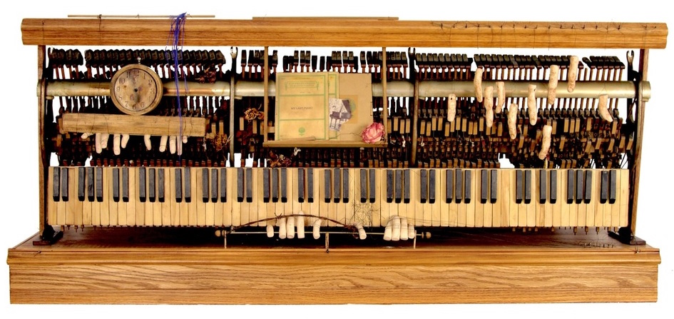 """In recent years, Wallace-Cohen has created a number of assemblage constructions. This one from 2013 is titled """"My Last Piano."""""""