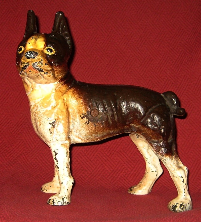 "This rare left-facing Boston terrier doorstop measures 9 3/4"" tall by 9 3/8"" long and weighs almost 6 pounds."