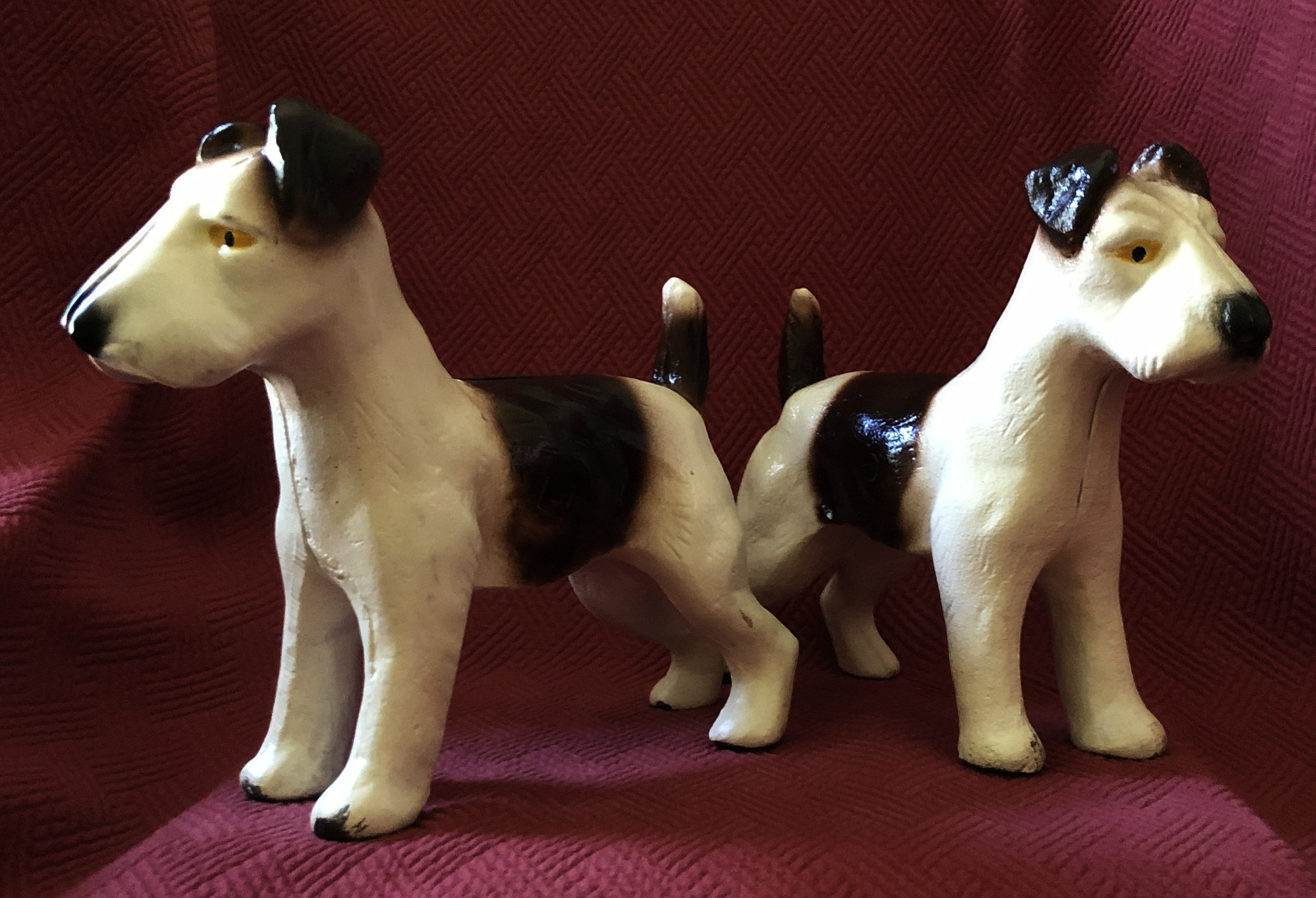 "Each of these two-piece, cast-iron fox terrier doorstops is held together with a single flathead slotted bolt and a square nut. Dimensions are 7 1/2"" tall by 9 1/2"" long, weight 5.6 pounds."