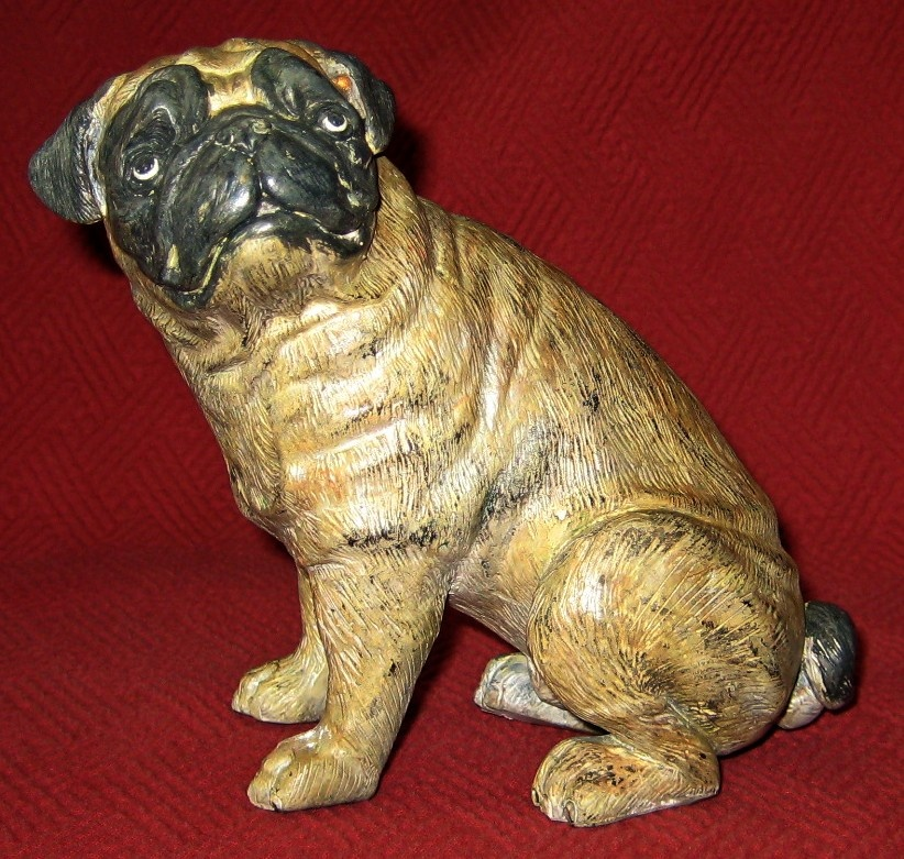 "This cold-painted bronze pug measures 5 3/4"" tall, 6"" long, and 3 1/2"" wide. The date is unknown, but the patina suggests it's been around a while."