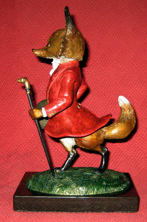 "Not all of the animals in Thompson's collection were designed to be functional. For example, this signed bronze sculpture from 1986, titled ""Master Of The Fox Hounds"" and numbered 28/50, is by artist Jenness Cortez. It's about 9"" tall (including base) and 5"" deep from front to back."