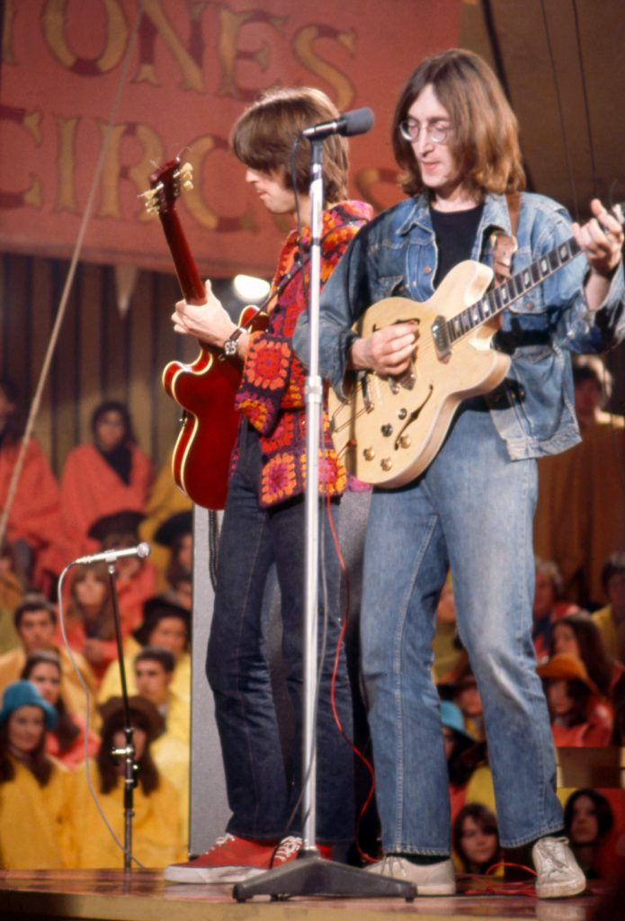 Eric Clapton, wearing a crocheted jacket by Birgitta Bjerke, performs with John Lennon during the Rolling Stones' Rock and Roll Circus, December 11, 1968.