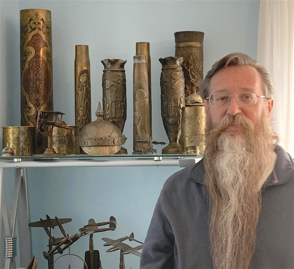 Scott Vezeau with a portion of his trench art collection, 2021.