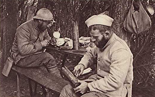 """In this widely circulated """"Official French Photograph"""" taken during the Great War, French infantrymen, known as Poilus, make trench art from 75mm artillery shells. Although some trench art was certainly made inside the trenches, much of it was created in informal settings like this."""