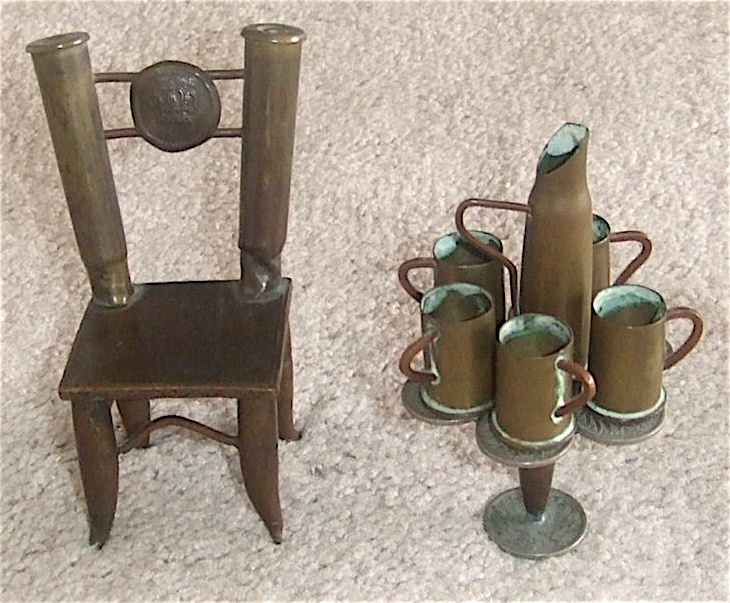 Rifle shells, bullet heads, German coins, and a button from a German uniform are the main parts used for this trench art dollhouse furniture.