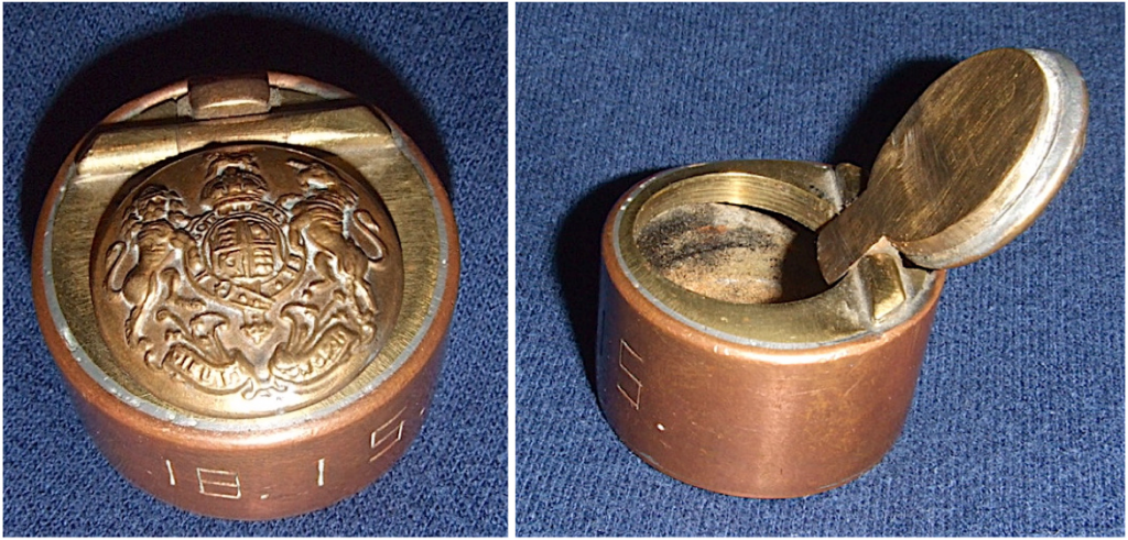 """This tiny (it's only 1 3/8"""" in diameter) Inkwell made of scrap brass and copper features a British General Service button on its hinged lid."""