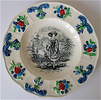 """In the center of this Patterson plate is the """"Highland Dancing Lass"""" pattern. The embossed pattern on the rim, though, has also been found paired with other transferware patterns."""