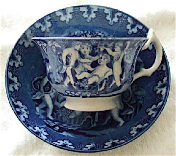 """A blue transferware pattern called """"Bacchanalian Cherubs"""" depicts the creatures feasting on grapes."""