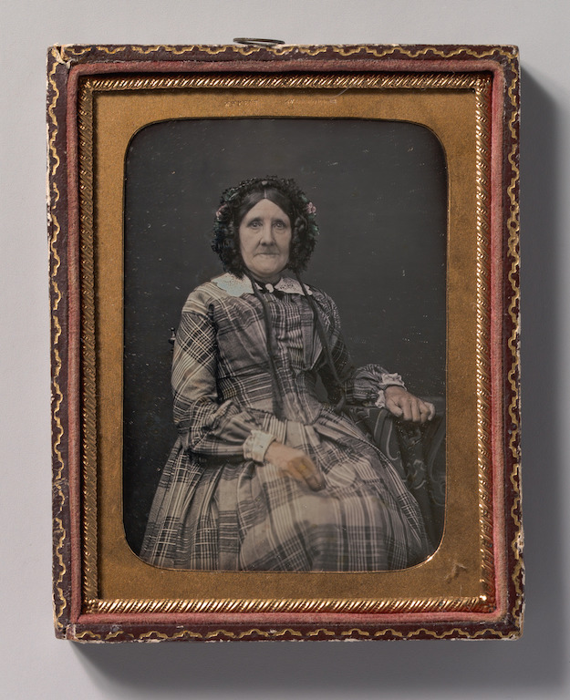 """Example of the use of a prop. William Hardy Kent, """"Untitled [Seated Elderly Woman Wearing Plaid Dress and Bonnet],"""" ca. 1854-1860. Daguerreotype."""