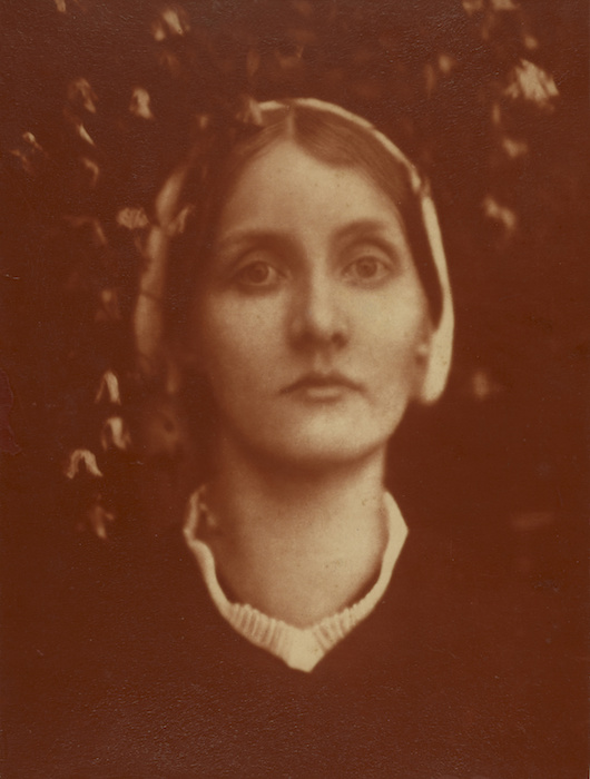 """Example of carbon print with red. Julia Margaret Cameron, """"My Niece and God Child (Julia) Mrs. Herbert Duckworth/A Beautiful Vision,"""" 1872. 13"""" x 9 13/16""""."""