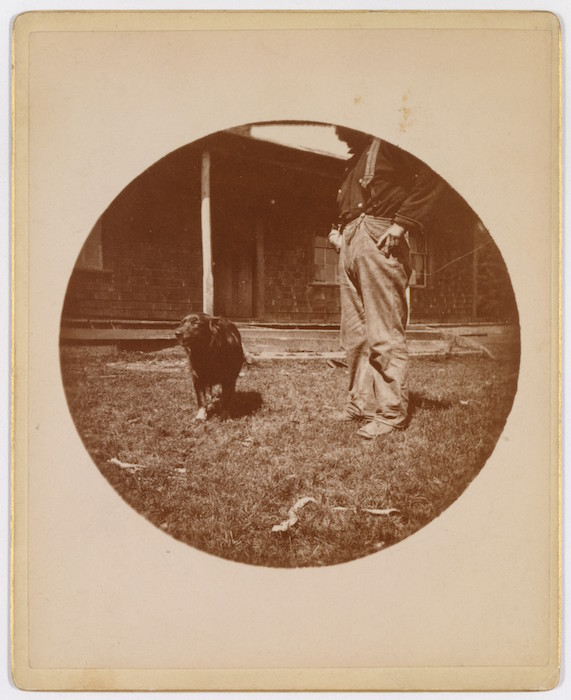 """Example of early Kodak photograph. Photographer unknown, """"Snapshot: Dog and Man,"""" ca. 1890. Gelatin silver print, 3 7/16"""" x 5 1/16"""" (card)."""